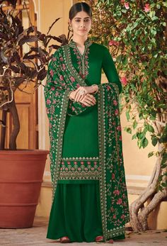 Green ora silk heer suit paired with a ora silk solid palazzo. This suit is beautified with heavy floral embroidery work over the top and dupatta. Salwar Kurta, Sharara Suit, Salwar Kameez Online, Designer Wear, Designer Dresses, Latest Anarkali Suits, Palazzo Suit, Palazzo Style, Embroidery Suits Design