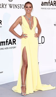 Glam at amfAR! Every Gown and Glittering Jewel at the Gala | People - Heidi Klum in a yellow Versace dress