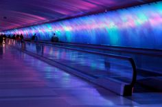 If your flying hopefully this will be on the way. McNamara Light Tunnel Airport Terminal in Detroit Michigan. Light patterns along the tunnel are choreographed with music. Gaia, Moving Walkway, Detroit Airport, Light Tunnel, Wayne County, Detroit Michigan, Metro Detroit, Exterior, Pedestrian