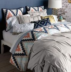love this bedding… I think this is a great cabin look without being woodsy or animal.  Maybe in boys guest.. or not… lol