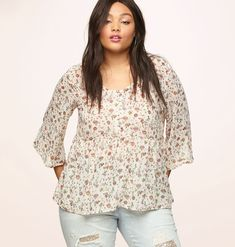 ce560e8655bfb Find new tops with a 90s feel like our plus size White Floral Babydoll Top  available in sizes 14-24 online at loralette.com. Avenue Store