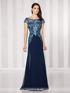 Cameron Blake - 216691 - Chiffon slim A-line gown with lace illusion cap sleeve and bateau neckline over a sweetheart bodice, dropped waist, V-back, sweep train. Matching shawl included. Sizes: 4 - 20 Colors: Pewter/Gray, Navy Blue/Turquoise