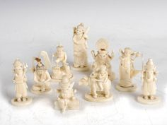 Lot 674 - A group of nine late 19th century Indian ivory figure groups, carved as Deities and figures from