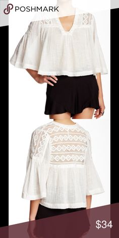 """NWT free people bell sleeve S Brand new white blouse crop with bell sleeve eyelet  White size S Bust 22"""" across front Free People Tops Crop Tops"""