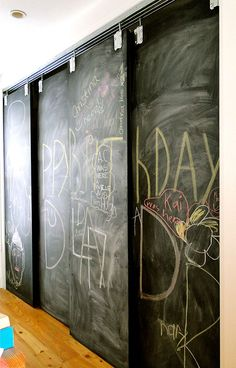 chalkboard bypass pantry doors hung using a barn door track - via Lynne Knowlton