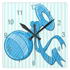 The adorable Boy Baby Rattle Square Wall Clock features a light blue and white striped background that is customizable, light blue baby ratt...