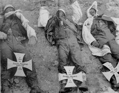 The bodies of three German paratroopers (Alwin Müssner, Günter Manneck, and Max Vogt) are laid out and photographed prior to their burial near Stalingrad, January 1943