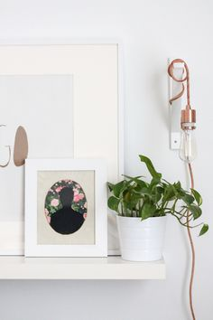 I like the idea of this portrait cut out or painted silhouette  (the link leads to a diy of the lamp, though)