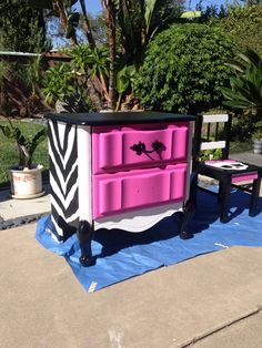 Repainted an old dresser for my daughters Monster High Theme bedroom. Pink with black and white zebra print.