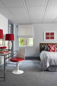 Brian Patrick Flynn designed a basement bedroom entry with a drop ceiling with high-end tiles complete with paneled, architectural detail.
