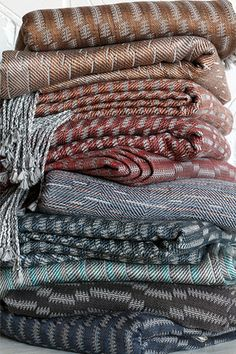 Stack of silk and merino handwoven shawls by Laura Adburgham Woven Textiles