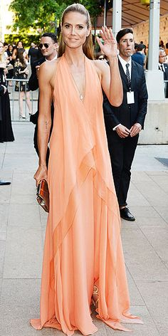 CFDA Fashion Awards: What the Stars Wore | HEIDI KLUM | Heidi didn't have to wait long between seeing this dress and wearing it. Her plunging orange Donna Karan halter with its tiered skirt is part of the designer's Resort 2015 collection that was shown earlier in the day!