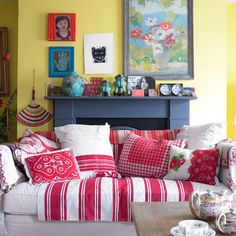 Lots of fun pillows and a pretty country throw over not so pretty sofas and chairs