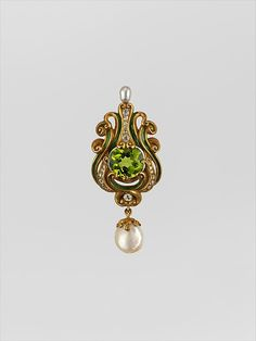 Marcus and Co. (American, 1892-1942). Brooch, ca.1900. Gold, peridot, diamonds, pearls, and enamel. The Metropolitan Museum of Art, New York. Purchase, Susan and Jon Rotenstreich Gift, 2001 (2001.238). #jewelry