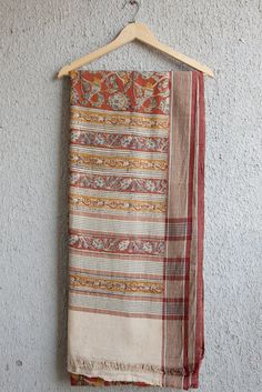 This pretty is easy to drape and is a great all day saree. The fabric is slightly thick and the material has natural fall. A process called baling, to compact c
