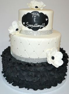 black, silver and white 3 tier ruffle cake