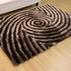 Whiz of a whirligig design in this fabulous taupe tone polyester #rug will definitely put you in a spin. - From £80.00 http://www.landofrugs.com/rugs/shaggy/taupe-spin-shaggy.html