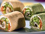 TURKEY PIN WHEELS  -1/2  cup light garden vegetable cream cheese  -4 wrap sized flour tortillas  -2 cups lettuce mix  -1 (8oz) package turkey slices  -1/2 Cup shredded carrots    DIRECTIONS:  Spread 2 tbsp cream cheese over entire surface of tortilla. Top cream cheese with 1/4 cup lettuce. Place 2 slices of turkey on 1/2 of each tortilla. Sprinkle  1 tbsp shredded carrots on top of turkey.    Roll the tortilla starting at the edge where you put the turkey.    cut into 1 inch slices