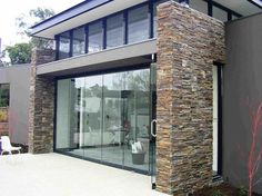ledgestone black windows frameless glass