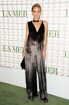 A Lesson In Party Dressing, Courtesy Of Nicole Richie #refinery29 http://www.pipeline.refinery29.com/2016/01/101520/nicole-richie-style-outfit-pictures#slide-2 Take one look at this velvet jumpsuit from another angle, and it can easily be mistaken for a dress. And we're very okay with that....