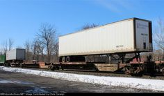 BNSF 300518  Spine car, USAZ 814219 Trailer. Description:  BNSF 300518 is seen in the consist of NS 212 at Allentown, PA. Car is ex FEC 300518/TR 300518.   Photo Date:  2/28/2015  Location:  Allentown, PA   Author:  Chris Carangi  Categories:  RollingStock