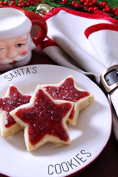 Truly magical! A New Christmas Classic ~ Scrumptious old-fashioned buttery shortbread kissed with sunny orange zest, pecans and a whisper of spices topped with Sugar Plum Jam. They are like a jam-topped English scone turned into a shortbread cookie!