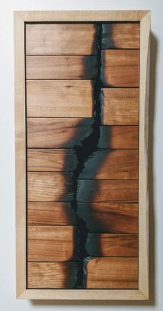 Feuer geborgen Kirsche Shadow Box This shadow box shows vibrant cherry wood salvaged from a fire barn in Shelburne, VT. The old dairy had succumbed to wood storage in recent decades until it struck by Lumber Storage, Wood Storage, Wooden Wall Art, Wooden Walls, Shadow Box Kunst, Wood Beds, Wood Working For Beginners, Woodworking Projects Plans, Shadow Box