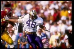 Linebacker Donald Jones of the Washington Huskies tries to break through the line during a game against the Southern California Trojans at the Los. Husky Football, Football And Basketball, College Football, Washington Huskies Football, Uw Huskies, Husky Husky, University Of Washington, Purple Reign, Athletics