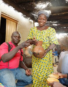 Serving Billibili, local beer brewn naturally from Hirse (millet/sorghum). Photo: ToSStudio via Flickr