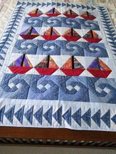 Baby quilt with sailboats and waves
