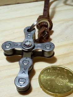 """This cross protects you no matter how narrow it gets! HG = Holy Ghost, PK = Protection Key. Bicycle chain art work """"Cross"""" necklace - now with a different type of chain, looks more industrial style, very nice, with a leather band! Work and design by chainworkaronge, in Málaga, 80 m behind the birth house of Picasso! Ride with no fear!"""