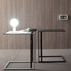 Square Console Table by Compar You can find this table in different colours which may go well with the rest of the room. Two tables together, but in different colours, could make your place shine with elegance and modernity. The contemporary and minimalist design makes it a great asset.