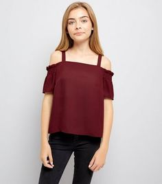 Teens. Bring the cold shoulder trend into your wardrobe with this burgundy shirred sleeve top. Wear with black jeans and sandals for a casual look.- Cold shoulder style- Shirred sleeve design- Square neckline- Casual fit that is true to size