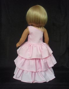 American Girl Doll Clothes Bridesmaid Gown Party Dress. Ready to ship.    This Gown is all about the girly pink ruffles! The dress is made with a recycled prom gown. Three tiers of ruffles form the skirt. Gown features a one shoulder bodice. Bodice is fully lined. Velcro provides closure at the side. All seams are serged. You will receive one piece:  1. Doll Bridesmaid Dress  Ready to ship.    More American Girl doll clothes in my shop  https://www.etsy.com/shop/SewSoNancy...