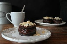 Gateau au chocolat filled with cacao and red wine frosting and covered with sliced almonds