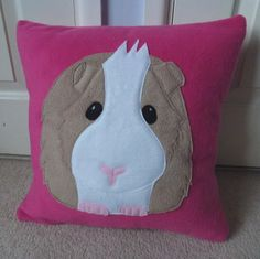 Pink Guinea pig cushion £20.00   -- create a pattern and make to match our piggies colors --- make as a large pillow for the couch.