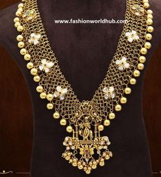 22 carat gold mesh haram that has floral polki diamond studded on over all haram adorned with gold balls with unique lord krishna pendant with a finishing work with gold balls byAmarsons Pearls & Jewels. 100 grams long chains designs, 150 grams long chains, 125 grams long chain designs