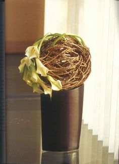 Calla lily grouping wrapped around one side of vine ball . . .
