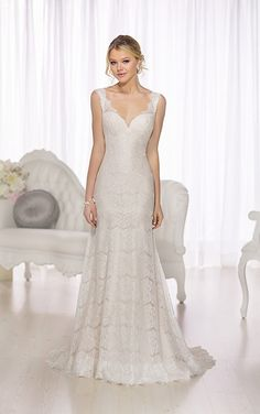 A modern take on a vintage favorite, this sheath gown from the Essense of Australia wedding dress collection features Lace illusion shoulder...