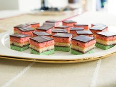 Neapolitan Holiday Cookies : These layered almond cookies topped with chocolate make a beautiful dessert that will impress any guest.