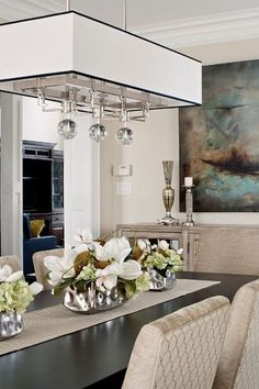Considering a dining room makeover with a modern chandelier? Chandeliers and dining rooms are a perfect match. Dining rooms should feel inviting and a well chosen modern chandelier can do that. Overall, choosing the perfect chandelier must make sense for the space it's in. Keep reading if you are ready to end your confusion about the best chandelier to incorporate into your living room, dining room, bedroom, kitchen ,and entryway. Hadley Court Interior Design blog.