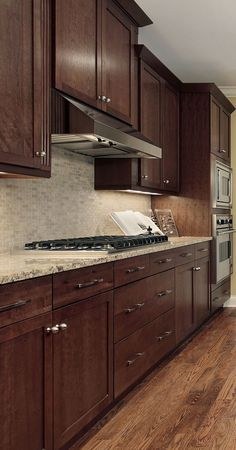 Cherry doors with dark stain. Cook top, wall oven, craftsman style. Craftsman Kitchen, Craftsman Style, Kitchen Backsplash, Kitchen Cabinets, Beautiful Kitchen Designs, Beautiful Kitchens, Cherry, Kitchen Remodel, Wall Ovens