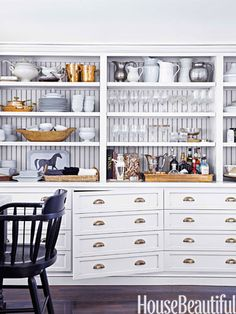 Get creative with your kitchen cabinets. Inspired by a vintage printer's desk, Monica Bhargava had the cabinets in her California kitchen made to look like drawers.