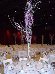 A tall, elegant centerpiece was used at this wedding at Illinois State University's Bone Student Center. More information at BoneStudentCenter.IllinoisState.edu