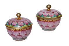A pair of antique Chinese porcelain bowls covered in lotus motifs. The pair of porcelain bowls dates back to the 19th century during the Qing Dynasty.