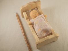 Little baby doll in a wood bed waldorf doll por MainsDeLaine