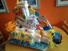 I was asked to try and make a submarine under the sea diaper cake. I had only done 3 tier diaper cakes and diaper bassinets, so this was something I reall Baby Shower Cakes, Baby Shower Themes, Baby Shower Gifts, Baby Gifts, Baby Showe Ideas, Shower Ideas, Cool Birthday Cakes, Baby Birthday, Diaper Bassinet
