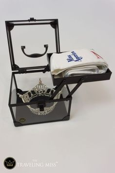 This is a necessity for any pageant titleholder on the move. This box was specifically designed for the pageant titleholder. The top compartment is perfect for your sash. Open it up, and your crown fits perfectly in the bottom compartment.