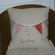 this cushion has a really cute bunting design appliqued across the front.The front of the cushion is made from a buff coloured textured linen fabric , the back is made from a beige and buff coloured striped cotton twill, with an envelope opening. Patchwork Fabric, Fabric Scraps, Linen Fabric, Scrap Fabric Projects, Sewing Projects, My Baby Girl, Baby Girls, Bunting Design, Sewing School