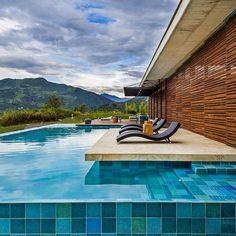 Responsible for this #jawdropping #pool area with beautiful #tiles, #sundeck and amazing #view of the #mountains is the team at arquitectura en estudio. Marvel at more fantastic #architecture on #homify!  #modernarchitecture #design #moderndesign #modernliving #swimmingpool #Colombia #clouds #nature #landscape #views #relax #enjoy #unwind #getaway #retreat #wood #timber #wooden